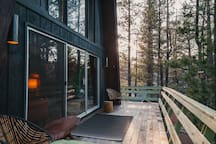 The deck wraps 3/4 around the cabin and exits right into the National Forest in the back. You can sit out here and watch the neighborhood birds (there are LOTS of them) fly in and out of the bird feeder.