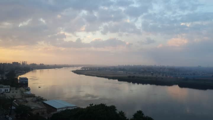 Nile view with sun set and pyramids,capture hearts