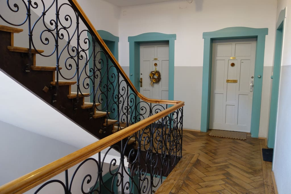 ... with an awesome staircase and beautiful wooden floor...