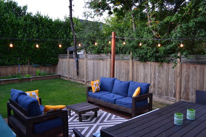 Our back yard is a private oasis after exploring our city. Comfy seating, a bbq, a great grassy area, toys, and a hammock for hanging!
