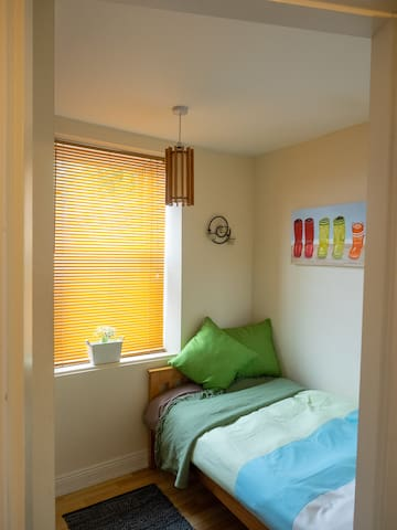 The single bedroom and blinds
