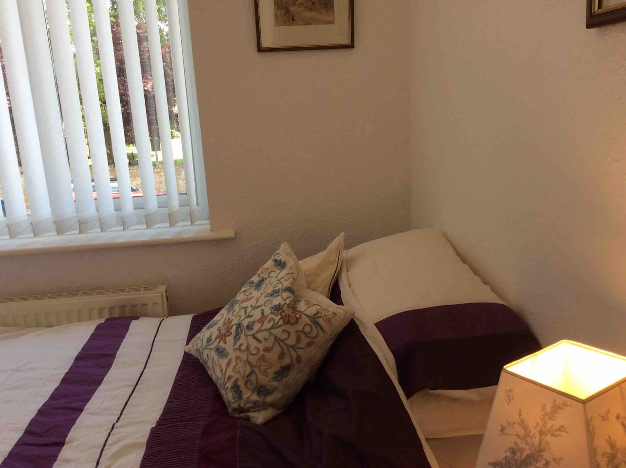 New and very comfortable single bed in very cosy room, with lots of storage space for clothes .  Large luggage items can be stored for you securely elsewhere if necessary.   Shared huge clean bathroom .