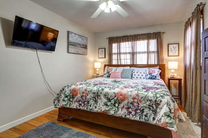 Master bedroom has King size bed. Blinds behind the curtains keep it dark in the morning for those who like to sleep in.