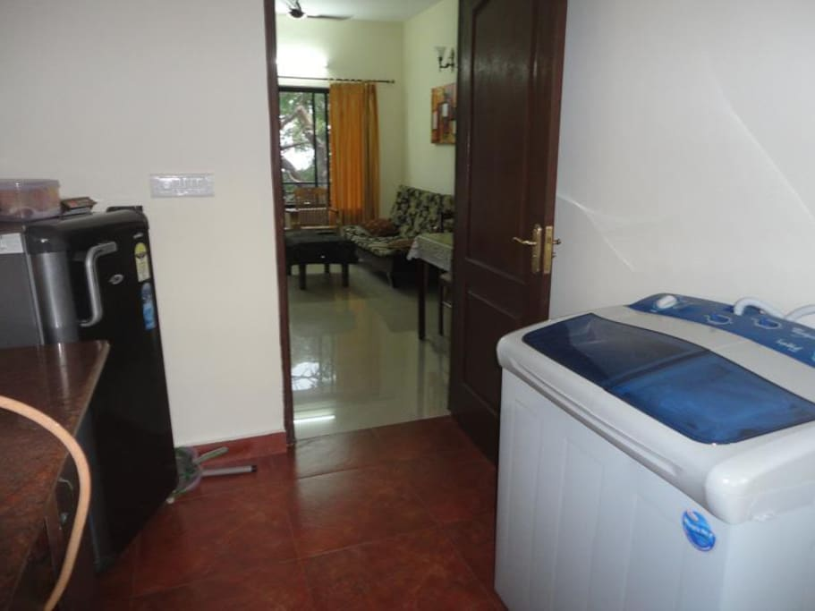 Kitchen view with refrigerator and washing machine