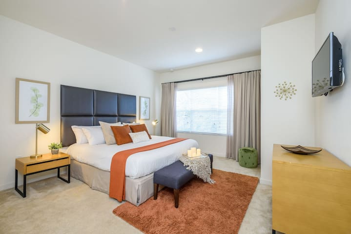 King Size Bed in the calming and modern master bedroom (private bath attached).