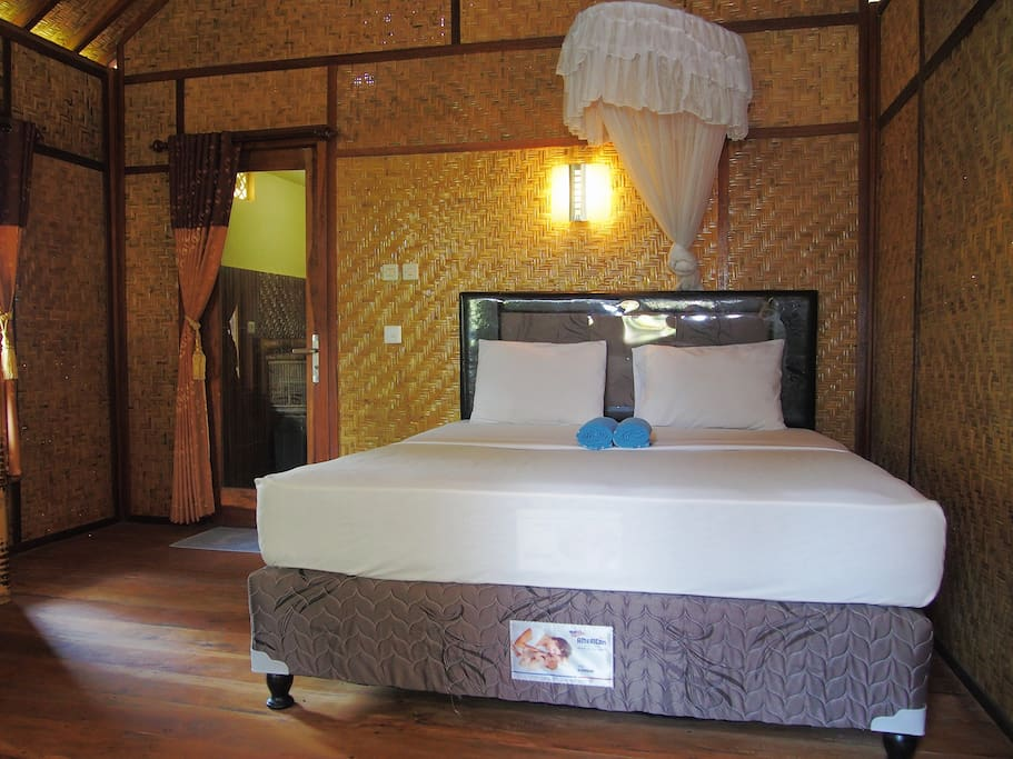 Double bed with mosquito net.
