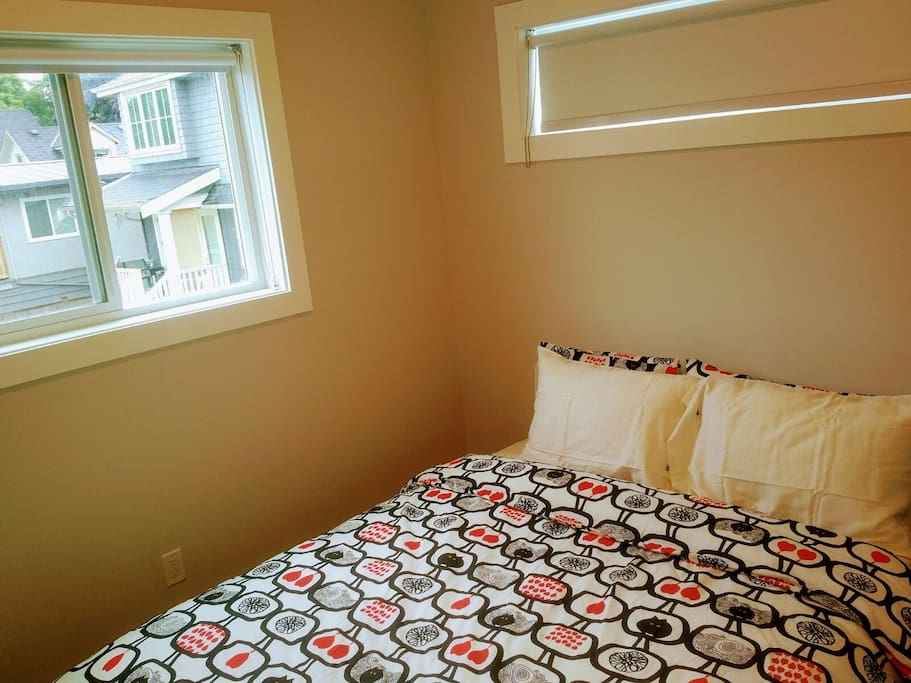 2nd bedroom located at 2nd floor with queen bed.
