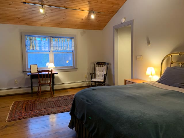 Wide Pine Floors, cathedral ceilings and queen bedroom suite.