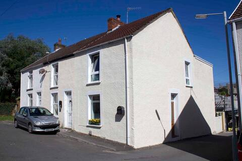 Howards End cottage Mumbles with views