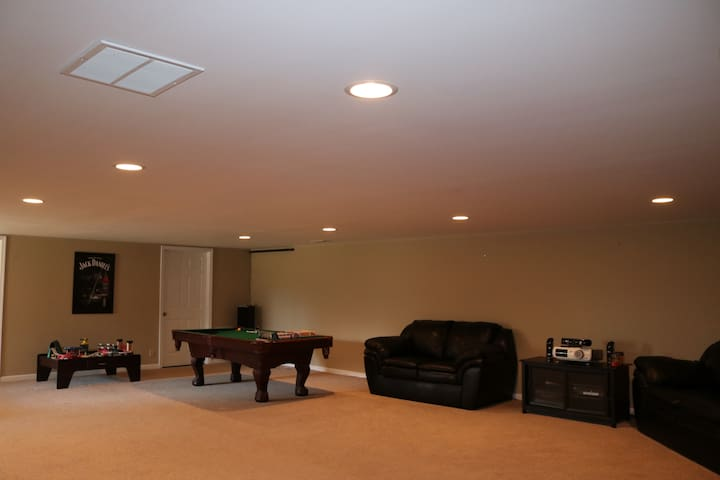 1,000 Sq Ft. Family Recreation Room with multiple activities.