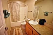 Hall bathroom with tub/shower combo.