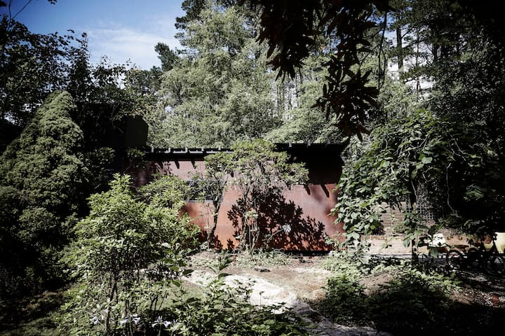 Rusted Steel Cabin Amongst the Trees