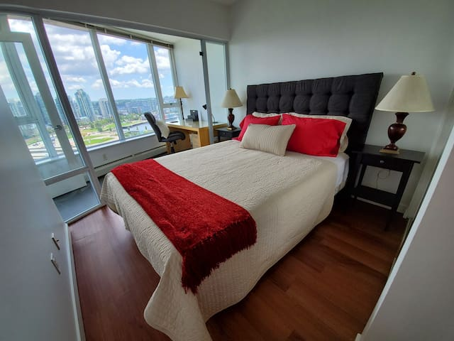 Queen size bed and personal office with an exceptional view.