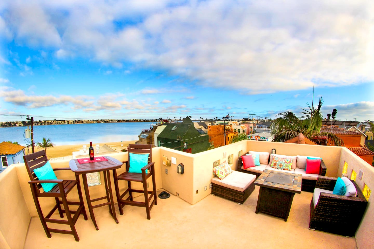 The rooftop deck is the perfect place to hang out with friends or family to enjoy the views of the bay and the ocean.  The deck features three separate spaces with plenty of seating for relaxing, dining and entertaining.