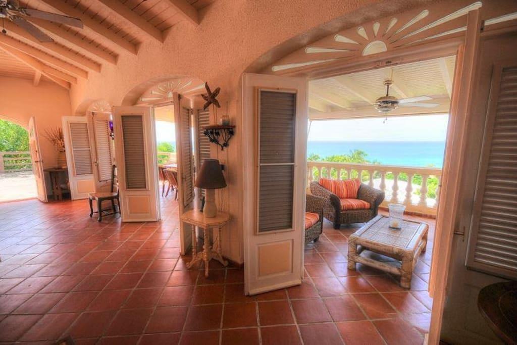Beautiful French doors open up to living veranda
