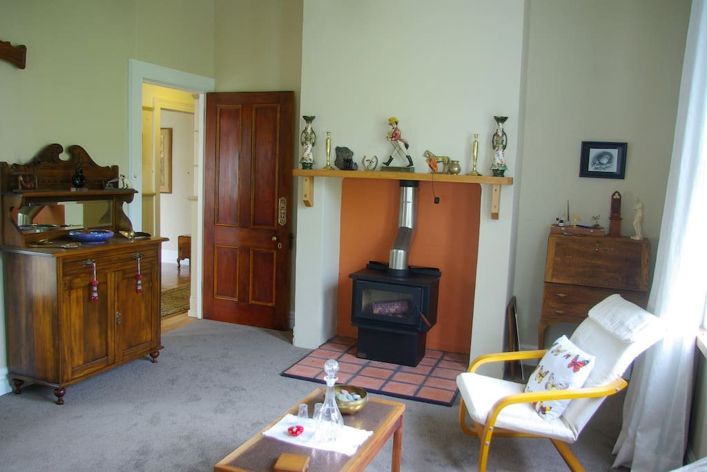 Large lounge with woodburner, tv, stereo, dvd player, etc.