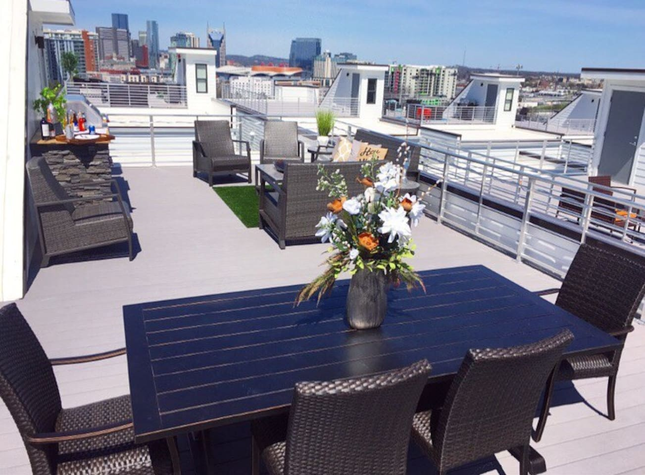 Gorgeous rooftop with skyline views, relaxing patio furniture, wet bar with grill & more!