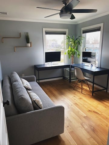 Office with sofa bed and cot.