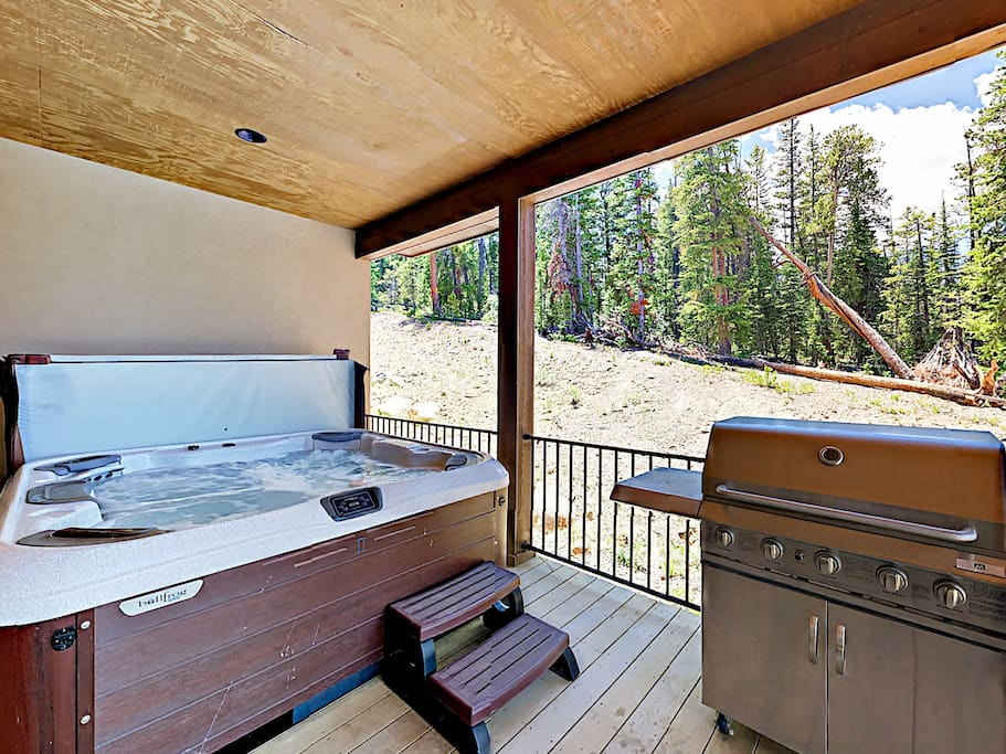 A gas grill and hot tub await on your private deck
