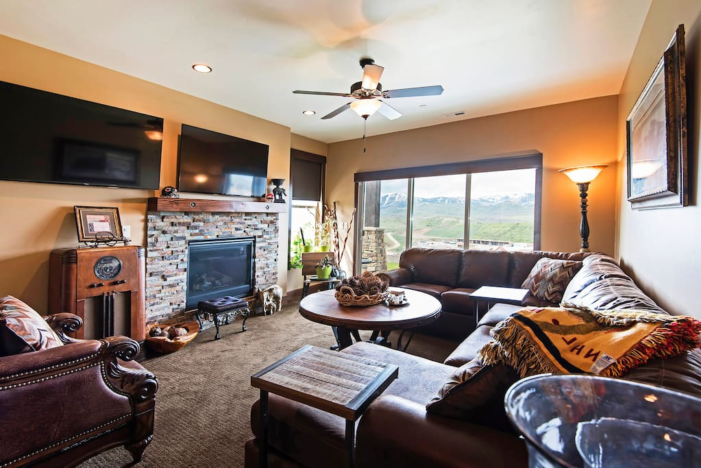 Family room with two flat screen TVs