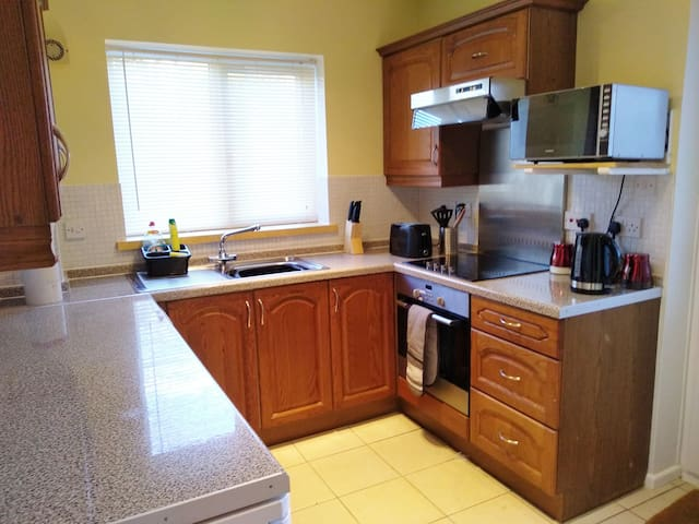 kitchen with hob, oven, microwave and all the bits and pieces needed to make a family meal.