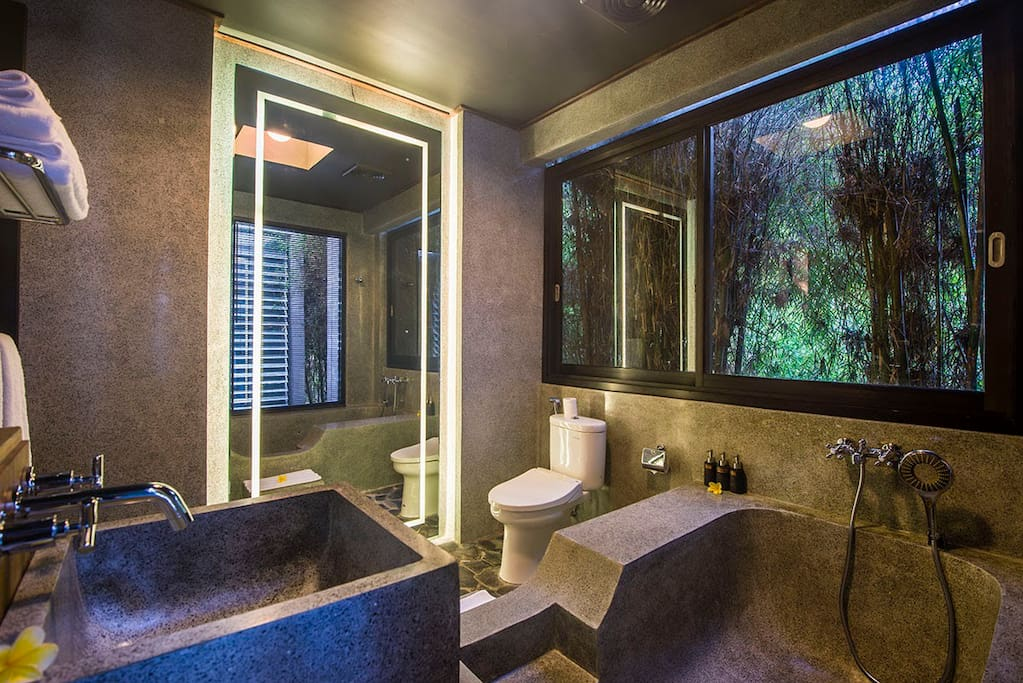 Enjoy views of the bamboo jungle from your oversized bathtub. (doubles as stand up shower)