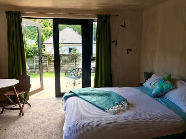 Studio bedroom opening onto private deck