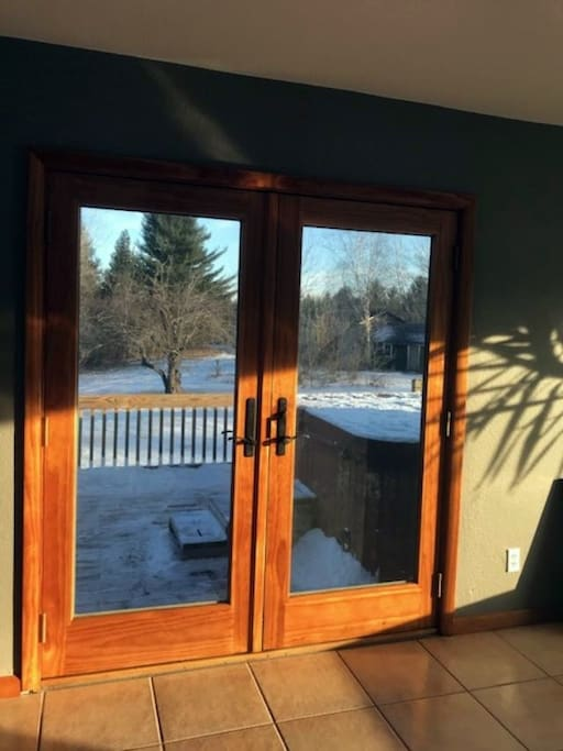 Patio door off master bedroom leading to deck and hot tub.