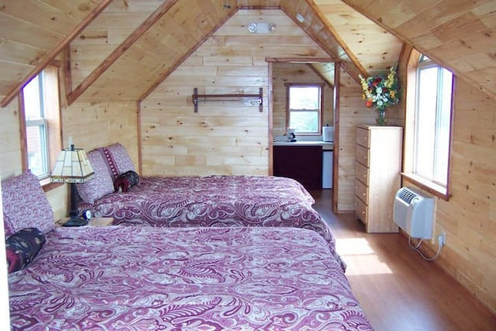 One of Our Stunning Queen Cabins with 2 Queen Beds