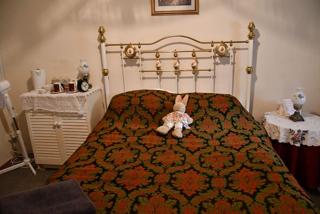 Room 1  has a queen bed, 3 chairs, a small table, dressing table, wardrobe and tea/coffee making area and a T.V.