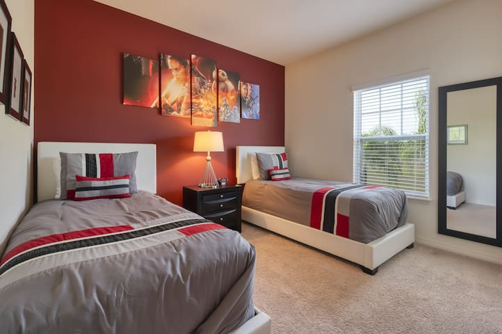 Bedroom 3 with two twin-sized beds and a TV.