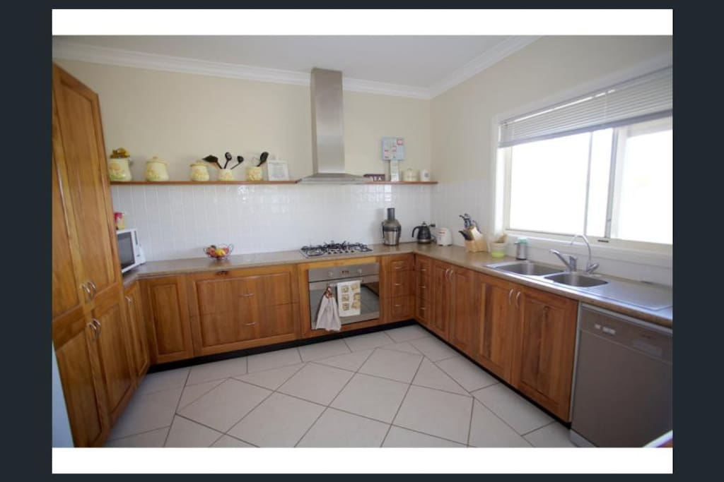 Large timber kitchen to     accommodate all your cooking                           needs.