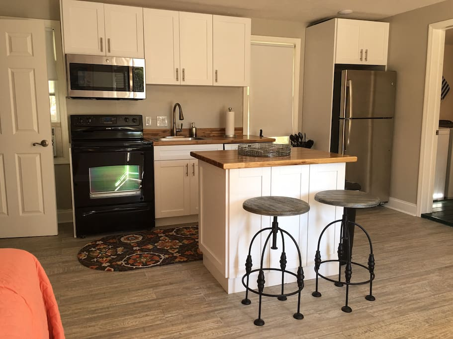 Full kitchen with stove, microwave, fridge, and dishwasher