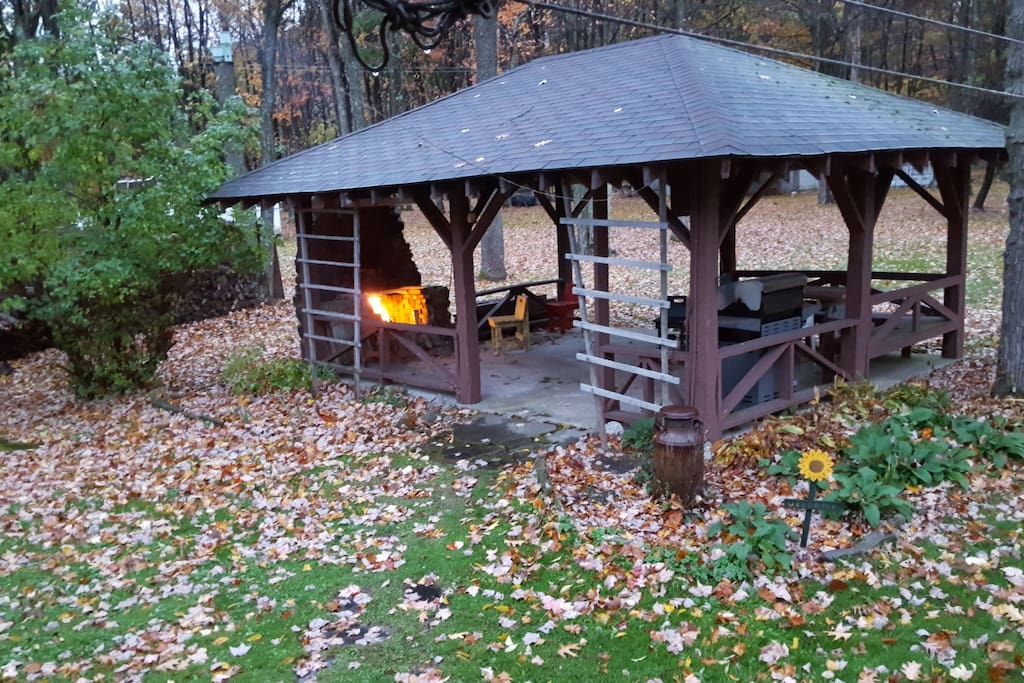Gazebo features an outdoor fireplace, gas grill and seating.