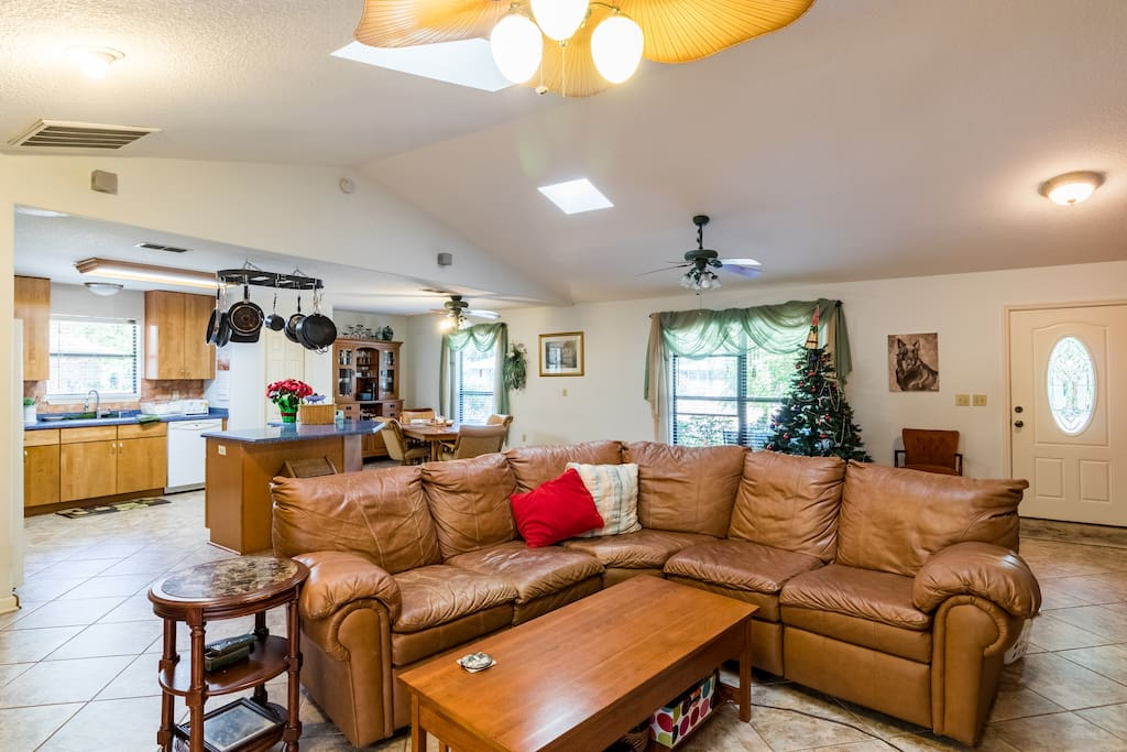 Open floor plan with vaulted ceiling and two sky lights