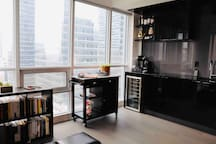 Library, stand-alone kitchen counter, wine fridge, kitchen stove top, Keurig and Nespresso