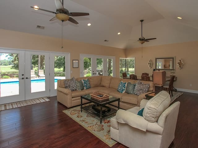 Living Area and Dining Area with Pool Deck Access at 16 Heath Drive