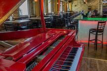Piano entertainment in hotel lobby's five star Italian restaurant
