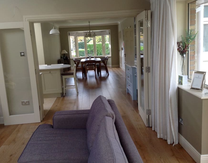 The family room is connected to the kitchen by glass bifold doors.