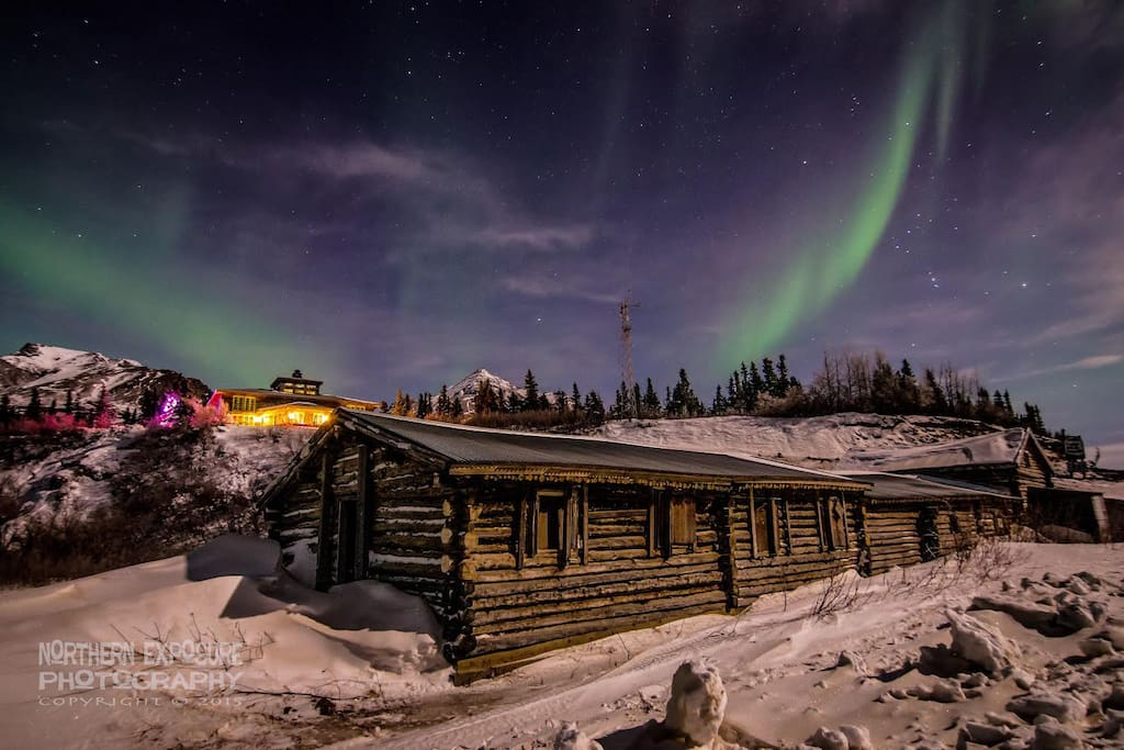 Northern Lights with the lodge and 100 year old roadhouse in the foreground.