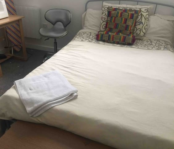Double bedroom with comfortable soft double bed, laptop table, WiFi and clean towels.