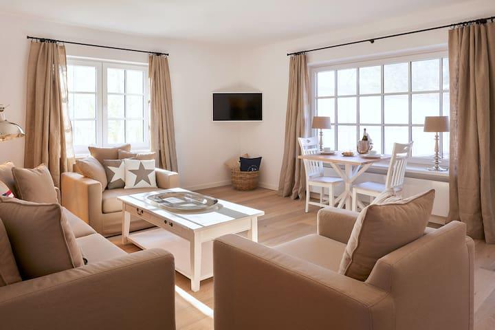 Gemütlichkeit trifft Luxus Apartment mit Garten