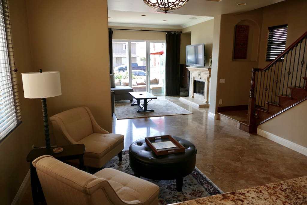Great room: living space, Big Screen TV, surround sound, stairs to 2nd & 3rd levels, reading nook, travertine floors