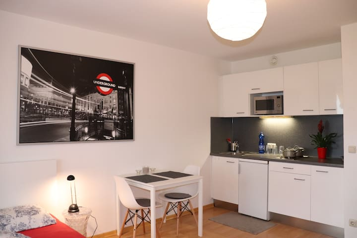 Small integrated kitchen and seating area