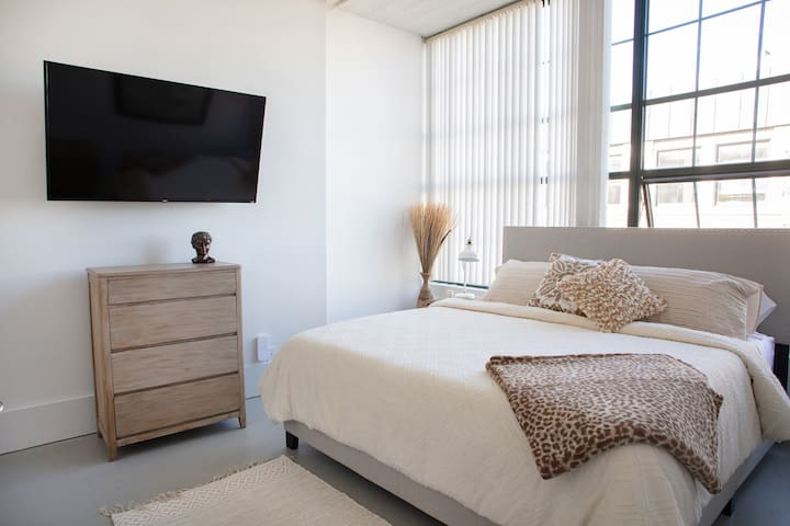 Beautiful King Bedroom with 55 in smart TV.