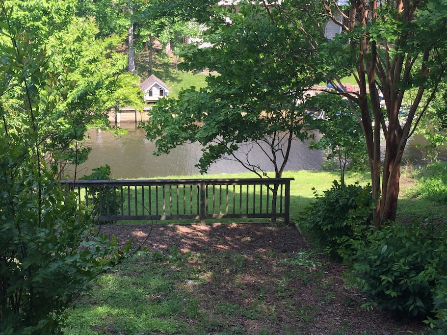 View from screened in deck of lake and dock.