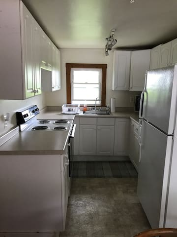 Full equipped kitchen- full frig, stove, microwave, coffee maker, toaster. Plenty of room for a couple of cooks.