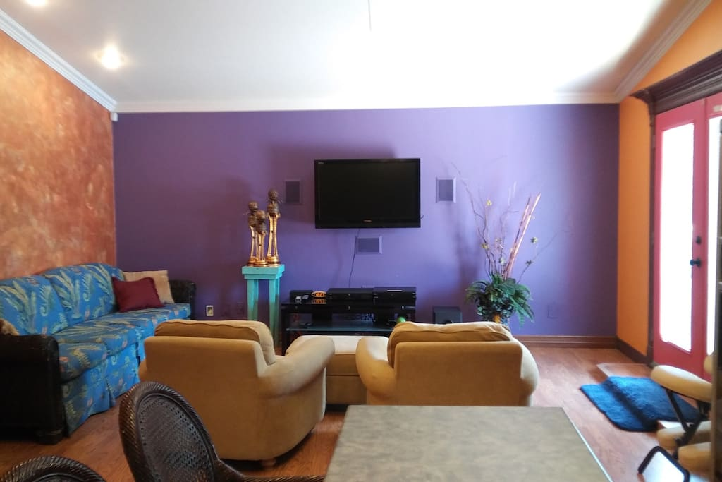 This is the TV room. You can listen to your shows or music from this room as well as outside on the terrace or in your beautiful bathroom. Dish and Netflix are included.