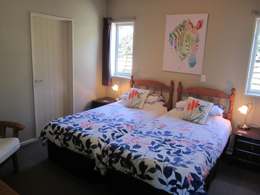 Twin Bedded Room with direct access to bathroom. There is another door to bathroom from hallway