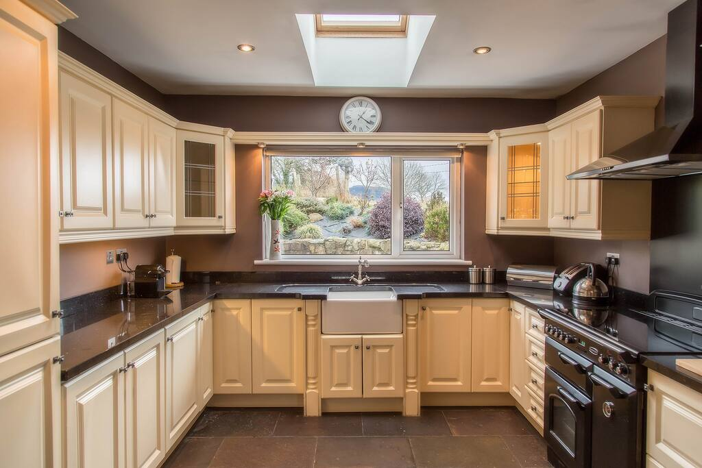 Fully equipped kitchen including microwave, dishwasher, slow cooker, Nespresso coffee maker.